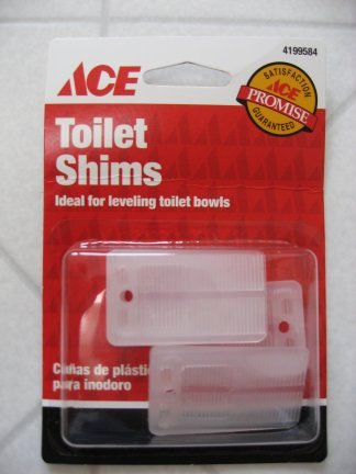 Use shims to level the toilet as needed